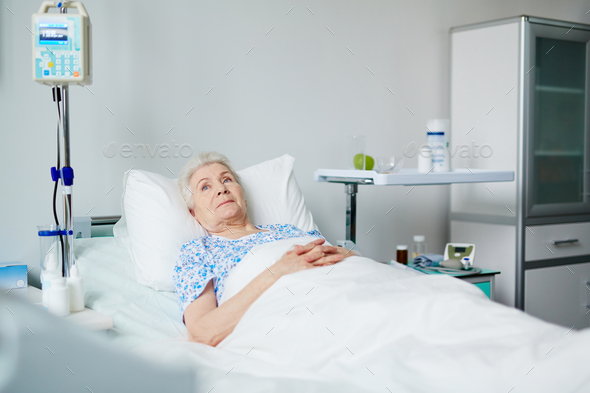 Patient in bed - Stock Photo - Images