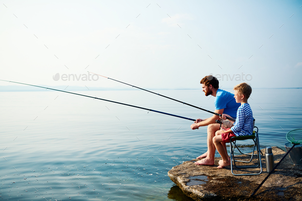 Fishing in river - Stock Photo - Images