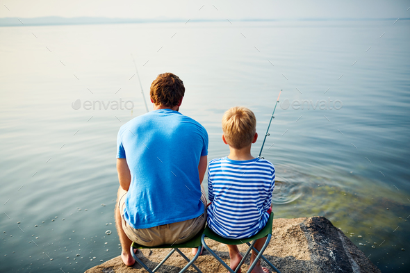Backs of fishermen - Stock Photo - Images