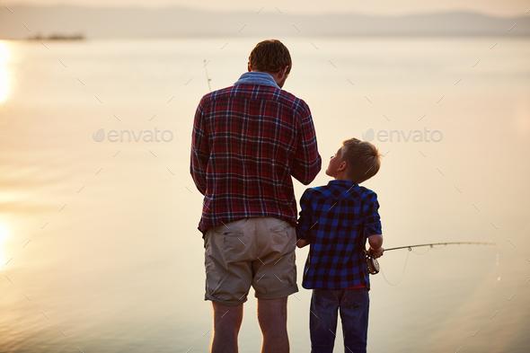 Fishing at sunset - Stock Photo - Images
