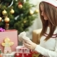 Young Beautiful Girl Wrapped The Christmas Gift - VideoHive Item for Sale