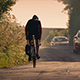 Cyclist On Country Road At Sunset - VideoHive Item for Sale