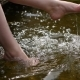 Girl Talks Feet In The Water Splashing Sun Glare - VideoHive Item for Sale