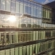 the reflection of the setting sun in the Windows of an office building - VideoHive Item for Sale