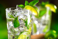 Mojito cocktail on a table. Summer cocktail with rum, lime, mint - PhotoDune Item for Sale
