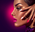 Sexy model with brown skin and purple lips over dark background - PhotoDune Item for Sale