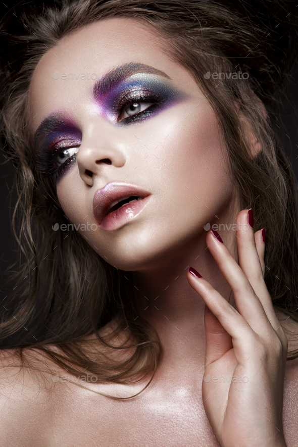 Beautiful young model with bright make-up - Stock Photo - Images