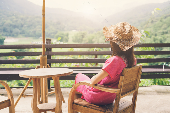 young traveler woman sit in a chair on the balcony - Stock Photo - Images