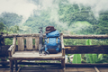 Travel backpack on the wooden bench - PhotoDune Item for Sale