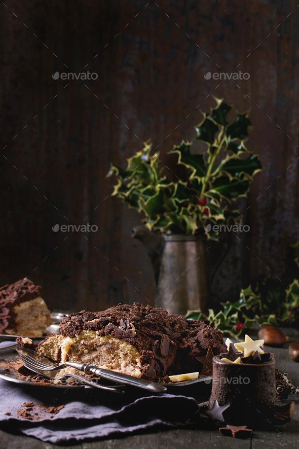 Sliced christmas chocolate yule log - Stock Photo - Images