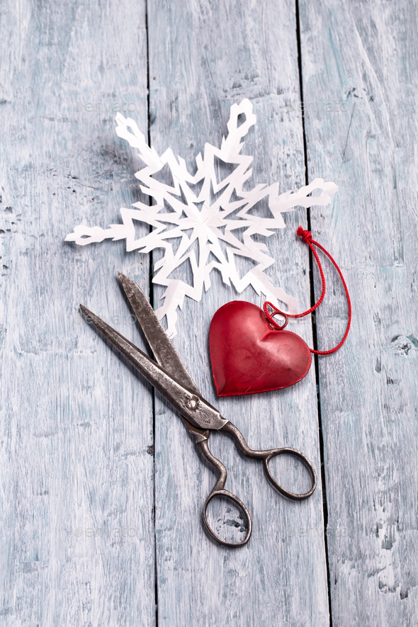 Vintage scissors, handmade paper snowflake and heart decoration - Stock Photo - Images