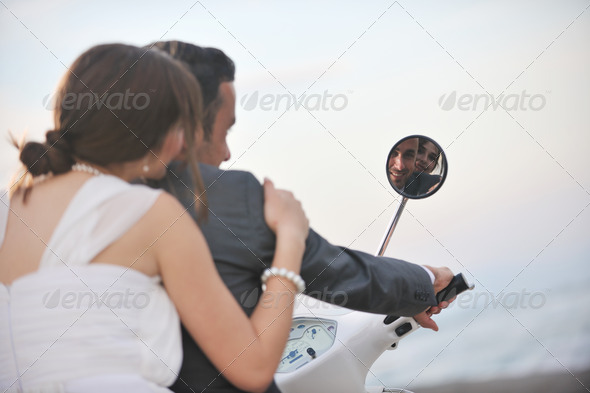 just married couple on the beach ride white scooter - Stock Photo - Images