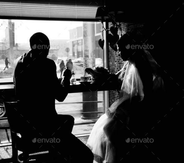 Silhouette of bride and groom in cafe - Stock Photo - Images