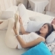 Happy Couple Reading a Book Lying On The Bed - VideoHive Item for Sale