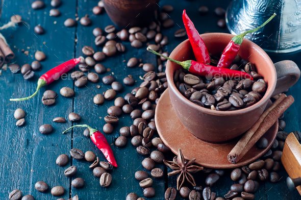 Coffee beans and red chilly peppers - Stock Photo - Images