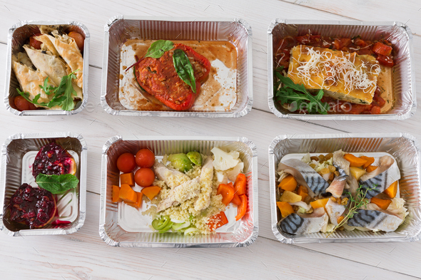 Healthy food take away in boxes, top view on wood - Stock Photo - Images