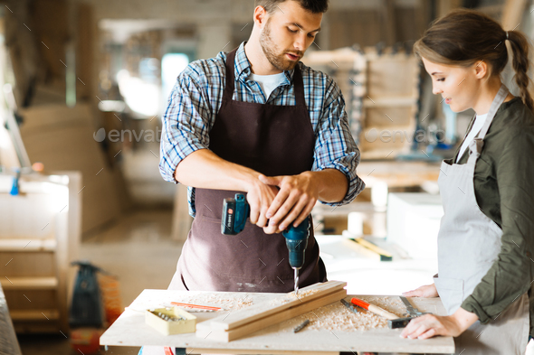 Carpenter and his assistant - Stock Photo - Images