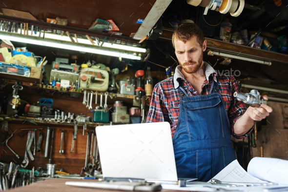 Busy mechanic - Stock Photo - Images