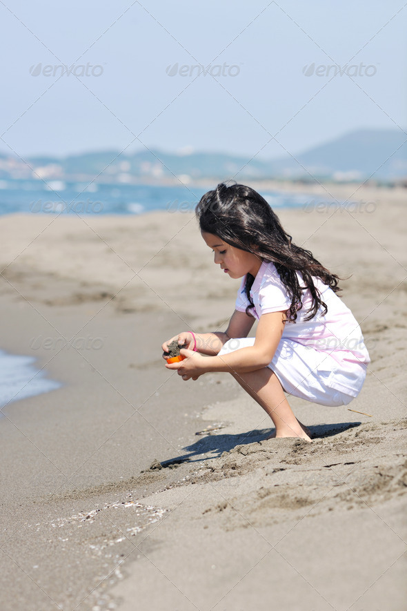 little female  child portrait on the beach - Stock Photo - Images
