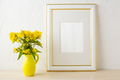 Frame mockup with small yellow flowers in stylized pitcher vase - PhotoDune Item for Sale