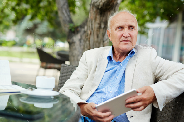 Senior businessman at break - Stock Photo - Images
