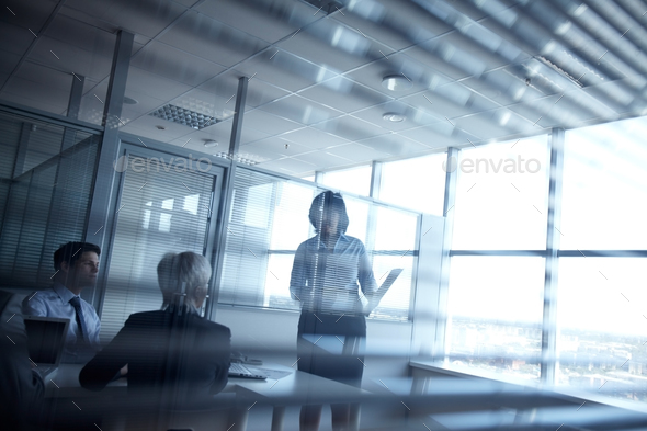 Meeting in dark room - Stock Photo - Images