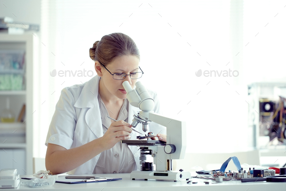 Working with microscope - Stock Photo - Images