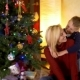 Happy Son Hugs Mom Under New Year Tree - VideoHive Item for Sale