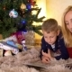 Mom Read Book With Son Under a New Year Tree - VideoHive Item for Sale