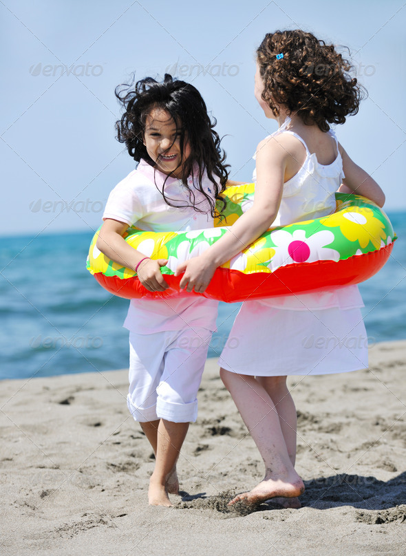 happy child group playing  on beach - Stock Photo - Images