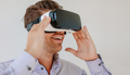 Happy young man wearing virtual reality goggle