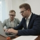 Two Successful Businessmen Working Together Looking At The Laptop Screen And Typing - VideoHive Item for Sale