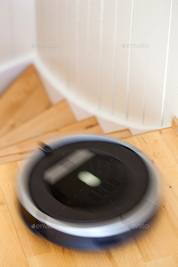 robotic vacuum cleaner on laminate wood floor smart cleaning tec - Stock Photo - Images