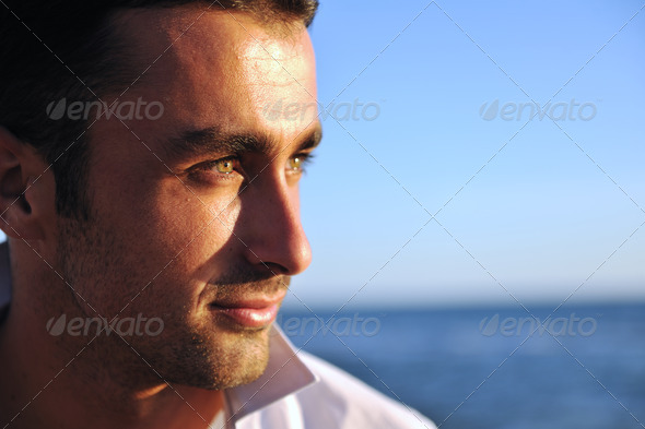 young man at beach - Stock Photo - Images