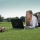 Businesswoman Lying On Green Grass With Laptop - VideoHive Item for Sale