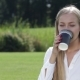 Cheerful Young Woman Drinking Coffee Outside - VideoHive Item for Sale