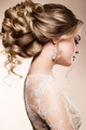 Beautiful bride with fashion wedding hairstyle - on beige background. - PhotoDune Item for Sale