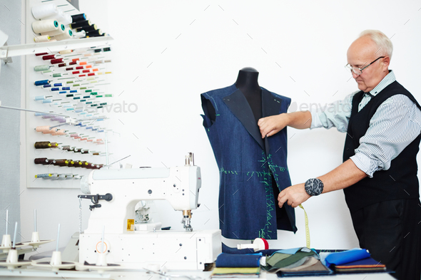 Dressmaker at work - Stock Photo - Images