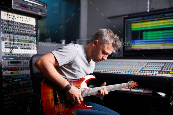 Working in audio studio - Stock Photo - Images
