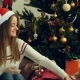 Young Beautiful Girl Wraps a Christmas Gift - VideoHive Item for Sale
