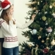 Pretty Girl Talking On The Phone Nearby Christmas Tree - VideoHive Item for Sale