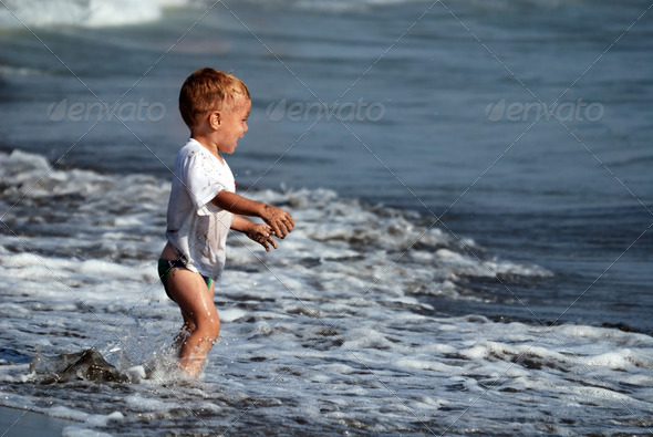 little boy at the beach - Stock Photo - Images