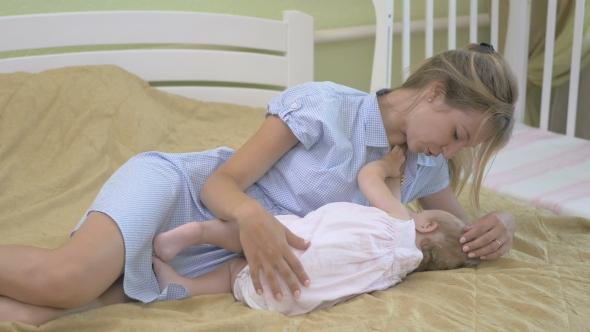 Mom breastfeeding her teen daughter