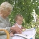 Grandma Reading a Book To Her Granddaughter. - VideoHive Item for Sale