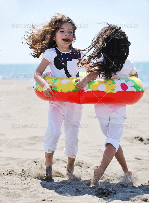 happy young  people group have fun on beach - Stock Photo - Images