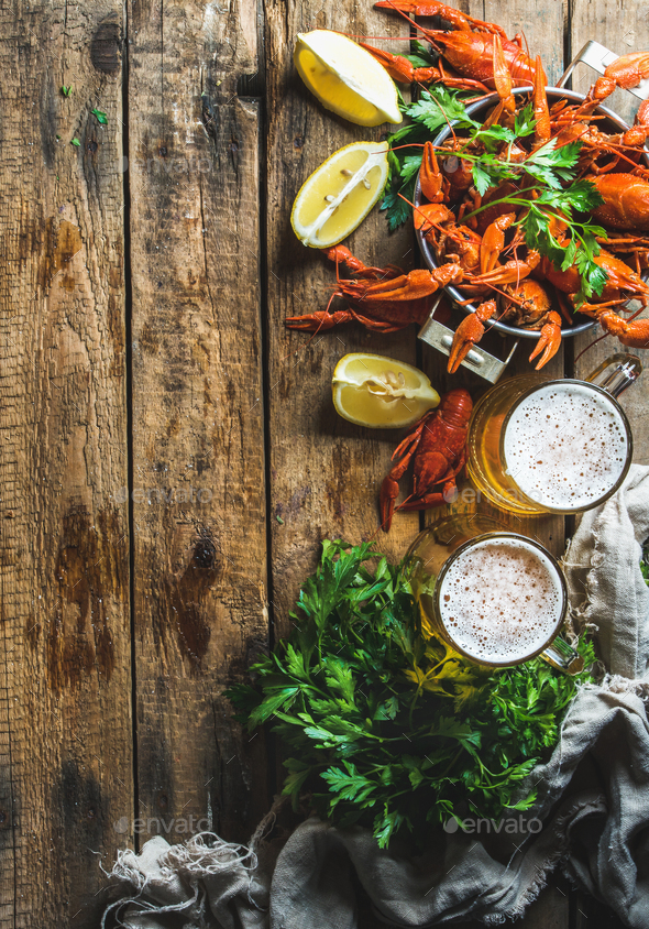 Wheat beer and boiled crayfish over old wooden rustic background - Stock Photo - Images
