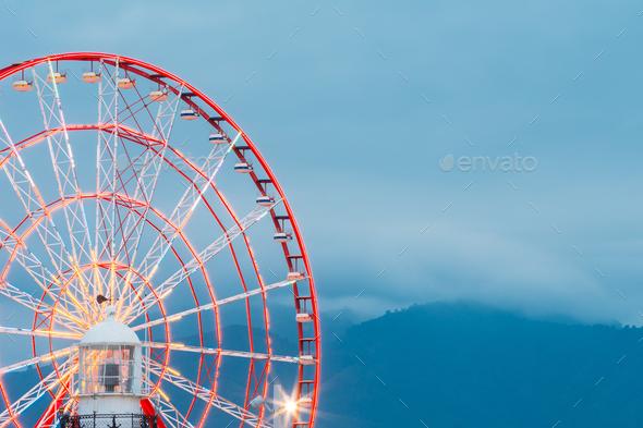 Batumi Georgia. Close View Of Ferris Wheel And Top Of White Ligh - Stock Photo - Images
