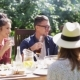 Happy Friends Having Dinner At Summer Garden Party - VideoHive Item for Sale