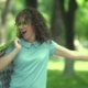 Curly Girl Dancing And Jumping In The Park. - VideoHive Item for Sale