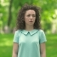 Young Woman Standing In a Park Sneezes. - VideoHive Item for Sale